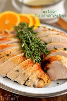 This Slow Cooker Citrus and Herb Turkey Breast is, hands down, the most amazing turkey you will ever eat! Juicy, tender, succulent and bursting with flavor, this recipe is a necessary addition to your holiday feast! | https://MomOnTimeout.com | #Thanksgiving #Chistmas