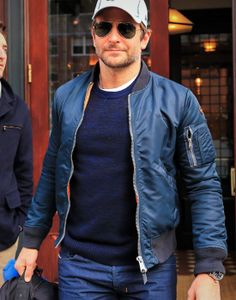 Bradley Cooper: Military influences like this pilot jacket and aviator sunglasses are investments that will never go out of style. They always look rugged, masculine, and slightly dangerous. I might recommend a plain cap instead of one with a logo.