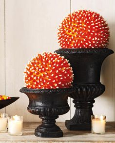 Candy corn, hot glue gun and a foam ball.....super easy!