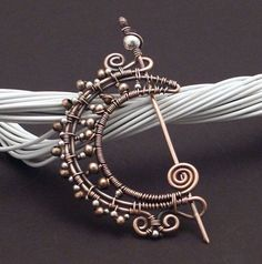 Copper sterling moon brooch.