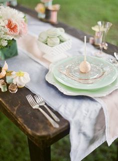 .love the vintage, mismatched place settings