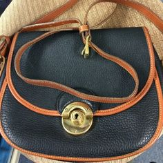 Vintage Dooney & Bourke leather Crossbody bag. Beautiful Vintage Dooney & Bourke all weather Crossbody bag. In fantastic EUC. Inside looks great. Wonderful Crossbody style. Measures 10 by 8. Adjustable Crossbody strap 46 inches to 50 inches. Please ask any questions. A beautiful piece of vintage. Small surface scratches on clasp otherwise in great shape. Dooney & Bourke Bags Crossbody Bags