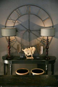 Home Design and Decor , The Elegant Wrought Iron Wall Decor : Wrought Iron Wall Decor Round Clock With Console Table