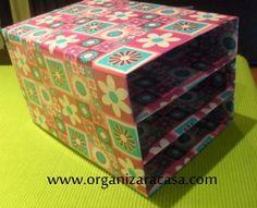Caixas de cereais forradas com papel de embrulho fazem um belo arquivo para papelada!