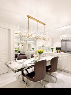 Click to discover Hausmann's interiors. #hausmann #luxuryinteriors #classicdesign #modern #elegant #interiordesign #interiordesigner #homedesign #homeinspo #luxurydesign Conference Room, Chair, Kitchen, Table, House, Furniture, Home Decor, Cooking, Decoration Home