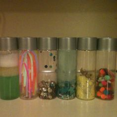 Sensory Bottles- 1. Water, oil, kitchen soap - shake to see parts separate 2. Glow sticks 3. Sequins and jingle bells 4. Ocean mix 5. Sand mix 6. Pom poms and glitter
