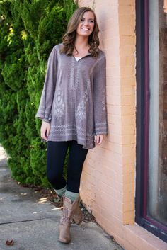 """This romantic tunic features breathtaking color and beautiful vine print. It's so perfect for a casual fall day because it look fantastic with go-to denim and boots!   Material has fair amount of stretch. Hood.  Sara is wearing the size small.   Length from shoulder to hem: S- 30.5""""; M- 31""""; L- 31.5""""."""
