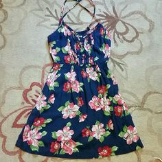 "Hollister Floral Sun Dress Adorable floral sun dress with light ruffles and buttons up the center of the bust. Elastic waist. 100% viscose. Very light and soft - perfect for the beach! Approx 23"" from underarm to bottom. Hollister Dresses Mini"