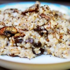 1/2 tablespoon olive oil  1/2 cup chopped red onion  4 crimini mushrooms, sliced  1 cup cooked oatmeal  1 tablespoon grated Parmesan  Salt and pepper to taste