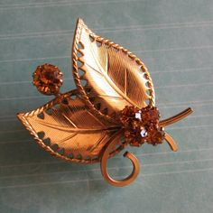Leaf Brooch with Rhinestones ??OBO?? A little tarnished, 1.5 inches wide  CLOSET CLEAR OUT! Taking all offers as long as they are made using the button! Also bundling for a bargain with 20% off 2 or more! Vintage Jewelry Brooches