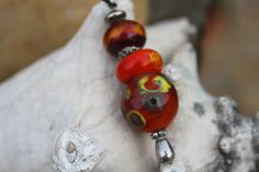 Pendant with three glass beads