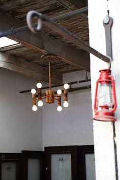 Croquet mallet chandelier - Evan & Oliver Haslegrave's home photographed by Jennifer Causey (via Design Sponge)