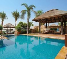 Poolside at Sofitel The Palm Jumeirah - luxury living at its best! Sofitel Hotel, Palm Jumeirah, Thatched Roof, Pool Bar, Concrete Jungle, Decking, Luxury Living, Hotels And Resorts, Gazebo