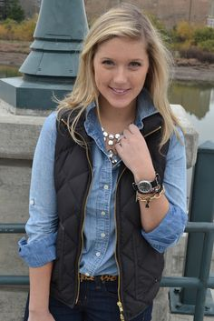 denim shirt, puffy vest, & statement necklace bling. loving the menswear inspired watch with the bracelets, too.