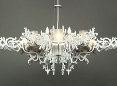 Laser Cutting: Erich Ginder created the Mansion Chandelier from laser-cut aluminium, glass and stainless-steel aircraft cable. It is a contemporary take on the traditional design, with the use of technology and unusual materials.
