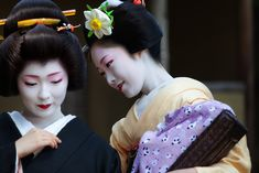 Geiko, Toshimana and Maiko, Toshikana. Kyoto. Japan.