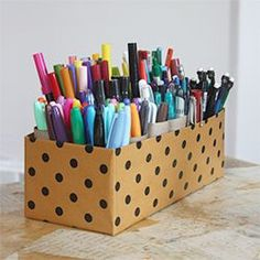 Ingenuous way to organize craft supplies using leftover cardboard tubes and an old shoebox.