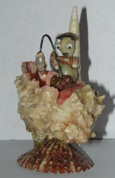 vintage SEA SHELL ART Fisherman Figurine w Google Eyes & Hat