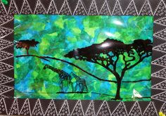 8th Grade - Arts and Activities - Serengeti Silhouette - Pattern - Sharpie on acetate, cool tissue paper collage.  White ink on black construction paper border