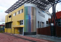 3 storey high curved multi coloured glass block panel at Caloundra, Queensland.