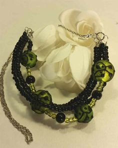 Green and black floral necklace