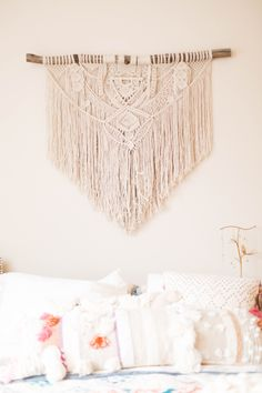 Macrame art above bed.