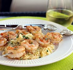 Grilled Shrimp with Garlicky Parmesan Orzo (I will make a marinade of melted butter, garlic and Old Bay Seasoning and marinate the shrimp in it for about 30 min before putting on the grill)