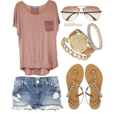 Layed back summer look of teeshirt ripped Jean shorts sunglasses and sandals