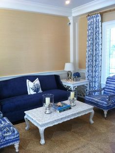 Patterned indigo chairs and curtains add global flair to this coastal space. (http://www.hgtv.com/designers-portfolio/room/traditional/living-rooms/13964/index.html?soc=Pinterest)