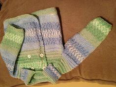 'Little Henry' sweater, pattern from Sublime #648; Bernat Baby Jacquards yarn. Was great to finish a knitting project...too long since last one done & unpacking at new house I realized I have way too much yarn to use up!