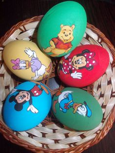 disney characters painted on wooden eggs