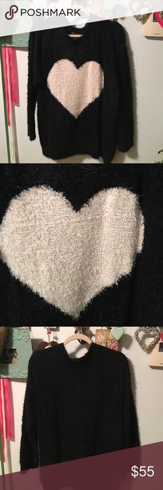🎀Sale🎀Faith & Zoe soft hear sweater. Never worn. New 🎀Sale🎀 reduced from $99-$79-$42 Black soft sweater with large white heart in a 1x. Never worn and feels so soft and cosy. Looks cream with lighting will take pics outside in morning show all white faith & zoe Sweaters Crew & Scoop Necks