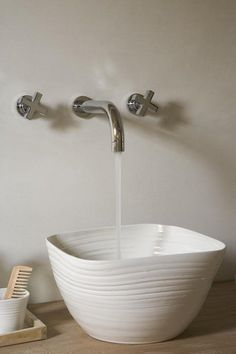 Hand-thrown basin, industrial faucet.