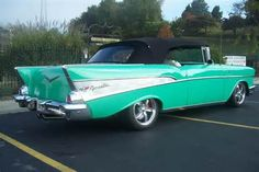 4.1957 Chevy Bel Air 2 door convertible turquoise with a black top!