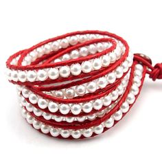 White Pearl on Red Leather White Pearl on Red Leather is made with breathtaking Tunellite Crystal 21mm circular beads around wrapped dark red leather. http://www.florencescoveljewelry.com/collections/wrap-bracelet/products/white-pearl-on-red-leather