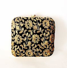 Beautiful floral applique black gold box clutch is sure to win your heart. This clutch has gold flower embroidery allover front and back with god