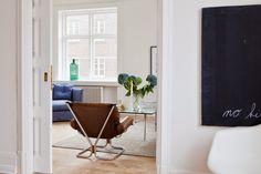 A calm white, blue and cognac Malm� home