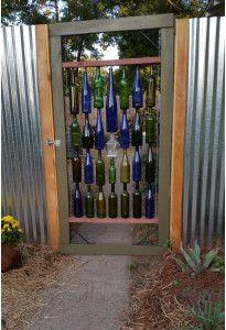 Making the Bottle Gate – Skivvy Nine Wine Bottle Fence, Bottle Garden, Wine Bottle Crafts, Bottle Art, Wine Bottle Trees, Recycled Bottles, Recycled Glass, Bottles And Jars, Glass Bottles