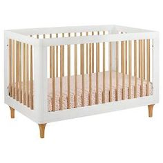 Delight in the playful joy of the Lolly 3-in-1 Convertible Crib! With natural spindles, gently curved corners, and delicate natural feet, the Lolly is a clever choice for the modern nursery. Lolly features hidden hardware construction, eco-friendly materials and finishes, and includes a toddler rail for later conversion. Pairs with Babyletto Lolly 3-Drawer Dresser Changer (M9023).