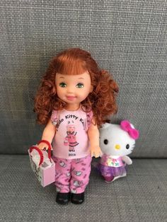 http://www.ebay.com/itm/Barbie-Kelly-OOAK-pretty-in-pink-Hello-Kitty-outfit-red-hair-green-eyes-/162602711825?hash=item25dbe07b11:g:61YAAOSwuVdZdK7t