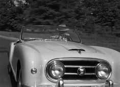 William Holden spots Sabrina upon her return from Paris. He's driving a 1953 Nash-Healey. The luxury sports car featured an American-made drive train and was assembled in Britain by the Donald Healey Motor Company. This body was designed by Pinin Farina.