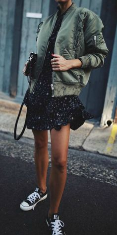 Bomber jackets + absolute modern classic + Andy + khaki piece + feminine floral tier dress + simple accessories + sneakers + street appropriate + casual look + girly and androgynous themes here!  Dress: Equipment, Shoes: Converse, Jacket: IRO Australia.