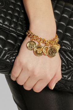 Versace Gold-Plated Swarovski Crystal Charm Bracelet http://rstyle.me/n/fkm9dr9te