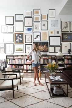 the home of Julia Leach Venice, California — huge gallery wall with library of books below living room eclectic home decor
