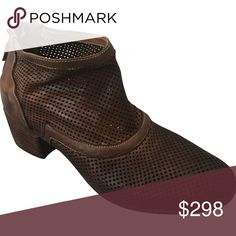 Gidigio Italian perforated leather bootie in Women This hand-crafted Italian bootie with perforated leather is sure to be your favorite year round ankle boot. Made in Le Marche, Italy since 1996 gidigio has been at the forefront of innovation and style in the fashion shoe industry.   Cushion insole 2 inch stacked heel Leather and Rubber Sole Back Zipper Made in Italy European Sizing - size up for comfort Size 38 and 40 Gidigio Shoes Ankle Boots & Booties
