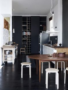 Perfectly Imperfect Kitchen, black + rustic  Wood counter top goes over onto side as well