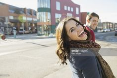 Stock Photo : Cheerful woman looking back on city street