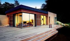 This self-build adopted an organic approach to materials and even has a natural swimming pond!