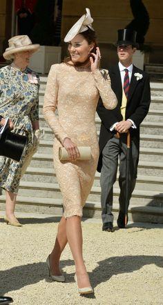 Kate Middleton in repeat Alexander McQueen an da new Jane Corbett hat. June, 2014.