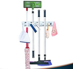 Broom and Mop Wall Mount Storage Holder Organizer By Mart Essentials - 5 Non Slip Rubber Adjustable Slots With Spring Controlled Balls 6 Folding Hooks For Mops Brooms Sports and Garage Tools - Keep Your Mops, Brooms And Handheld Tools Neatly Stored, Save Space And Perfectly Organize Your Kitchen, Garage, Laundry Room And Office Thanks To The Ultimate Wall Mop & Broom Holder!Have you had enough with stacking your brooms and mops behind doors? Would you like to neatly store your sports e...
